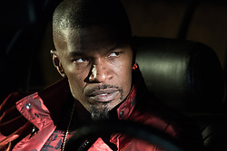 Bats (JAMIE FOXX) prepares for the gun deal in TriStar Pictures' BABY DRIVER.