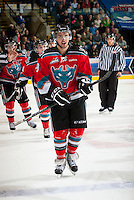 KELOWNA, CANADA - OCTOBER 10: Dylen McKinlay #19 of the Kelowna Rockets skates to the bench to celebrate a goal against the Spokane Chiefs  at the Kelowna Rockets on October 10, 2012 at Prospera Place in Kelowna, British Columbia, Canada (Photo by Marissa Baecker/Shoot the Breeze) *** Local Caption ***