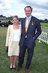 WILLIAM CASH and his wife ILLARIA at the Veuve Clicquot sponsored Gold Cup or the British Open Polo Championship won by The  Azzura polo team who beat The Dubai polo team 17-9 at Cowdray Park, West Sussex on 18th July 2004.