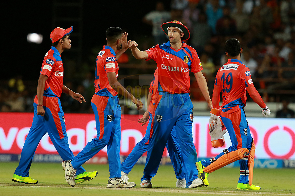 Dhawal Kulkarni of GL celebrates the wicket of Virat Kohli captain of RCB  during match 20 of the Vivo 2017 Indian Premier League between the Gujarat Lions and the Royal Challengers Bangalore  held at the Saurashtra Cricket Association Stadium in Rajkot, India on the 18th April 2017<br /> <br /> Photo by Rahul Gulati - Sportzpics - IPL