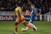 Hartlepool United midfielder Michael Woods makes a run into the ball past Anthony Stewart (Defender) of Wycombe Wanderers during the Sky Bet League 2 match between Hartlepool United and Wycombe Wanderers at Victoria Park, Hartlepool, England on 16 January 2016. Photo by George Ledger.