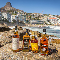 Bottles of Drayman's Highveld Single Malt Whisky, Knight's Blended Whisky, Three Ships Select Whisky, and Bain's Cape Mountain Whisky are seen on the beach near Lion's Head in Cape Town, South Africa, April 2, 2015. Gary He/DRAMBOX MEDIA LIBRARY