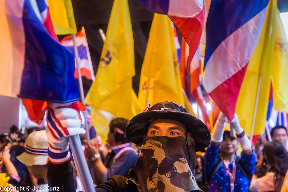 "09 DECEMBER 2013 - BANGKOK, THAILAND: Thai anti-government protestors rally on Silom Road in Bangkok before marching on Government House in Bangkok. Thai Prime Minister Yingluck Shinawatra announced she would dissolve the lower house of the Parliament and call new elections in the face of ongoing anti-government protests in Bangkok. Hundreds of thousands of people flocked to Government House, the office of the Prime Minister, Monday to celebrate the collapse of the government after Yingluck made her announcement. Former Deputy Prime Minister Suthep Thaugsuban, the organizer of the protests, said the protests would continue until the ""Thaksin influence is uprooted from Thailand."" There were no reports of violence in the protests Monday.      PHOTO BY JACK KURTZ"