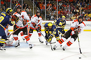 November 21, 2009:  Michigan's Chris Brown (10), BGSU's Ryan Peltoma (2), BGSU's David Solway (5), Michigan center Matt Rust (19), Michigan wing Carl Hagelin (12) and BGSU's Kai Kantola (14)  during the NCCA hockey game between Michigan and the Bowling Green State University at Lucas County Arena in Toledo, Ohio.