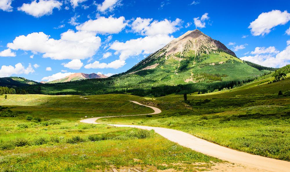 The twisting Washington Gulch Road to Gothic Mountain, Colorado.