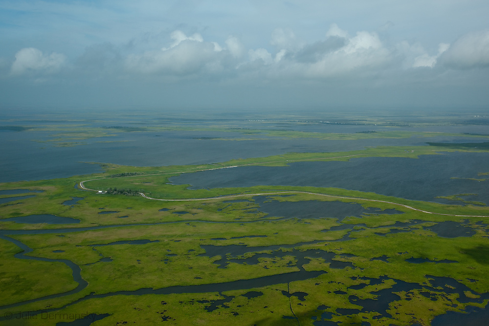 Louisiana's marshlands  full of man made waterways cut into the marsh by oil and gas companies. Louisiana's wetlands are threaten by coastal erosion, climate change and the oil and gas industry.