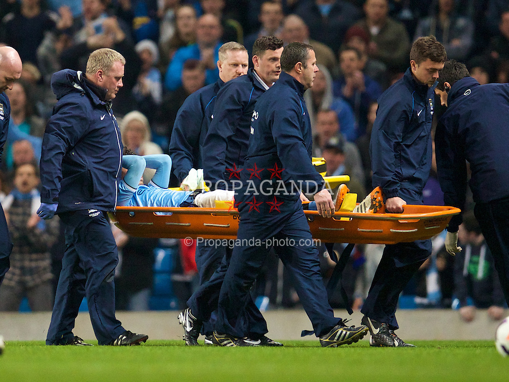 MANCHESTER, ENGLAND - Easter Monday, April 21, 2014: Manchester City's David Silva is carried off injured against West Bromwich Albion during the Premiership match at the City of Manchester Stadium. (Pic by David Rawcliffe/Propaganda)