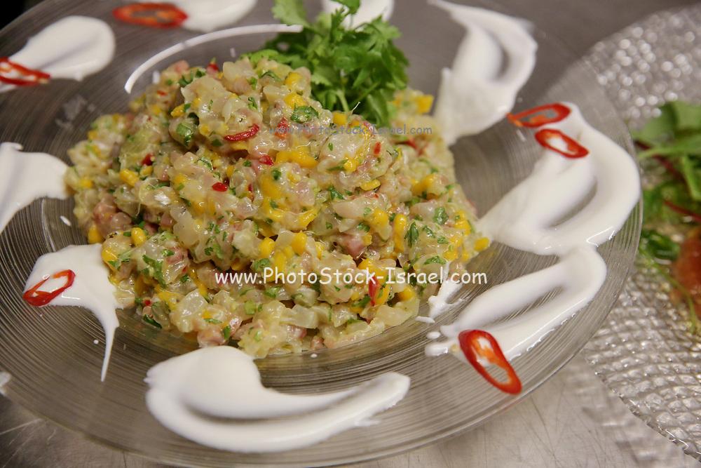 aubergine salad garnished with Tahini
