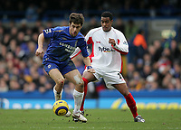 Photo: Lee Earle.<br /> Chelsea v Birmingham City. The Barclays Premiership.<br /> 31/12/2005.<br /> Chelsea's Joe Cole (L) holds off Julian Gray.