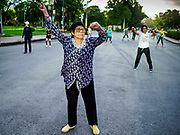 05 JUNE 2017 - BANGKOK, THAILAND: A woman participates in an adult aerobics class in Lumpini Park in Bangkok. Thai health officials estimate that about 17% of Thais are 60 years old and older, putting Thailand right on the cusp of being an aging society. Many public health centers and government offices in Thailand offer free exercise classes for Thai seniors in an effort to keep older Thais healthy and mobile.      PHOTO BY JACK KURTZ