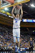 Nov 15, 2017; Los Angeles, CA, USA; UCLA Bruins forward Gyorgy Goloman (14) dunks the ball against the Central Arkansas Bears  during a NCAA basketball at Pauley Pavilion. UCLA defeated Central Arkansas 106-101 in overtime.