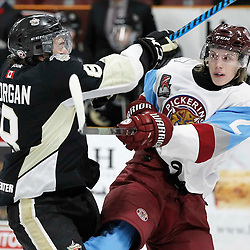 TRENTON, ON - NOV 4:  Liam Morgan #8 of the Trenton Golden Hawks makes the hit on Eric Becker #2 of the Pickering Panthers during the OJHL regular season game between the  Pickering Panthers and Trenton Golden Hawks on November 4, 2016 in Trenton, Ontario. (Photo by Amy Deroche/OJHL Images)