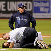 The Rays' trainer and manager Joe Maddon attend to Rays' Will Rhymes after Rhymes collapsed after being hit by a pitch in the eighth inning Wednesday, May 16, 2012 in St. Petersburg. Rhymes was later taken off the field. The Rays defeated Boston 2-1.