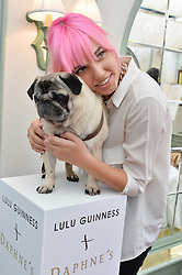AMBER BE BON and her dog Luigi at a party hosted by Lulu Guinness and Daphne's to launch Lulu's Designer Dog Bowl and to mark Daphne's allowing dogs through it's doors, held at Daphne's, Draycott Avenue, London on 28th June 2016.