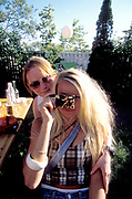 Two girls, one wearing a burberry top, holding a disposable camera, Quart festival, Kristiansands Norway 2000