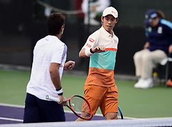 March 8, 2019 - Indian Wells, CA, U.S. - INDIAN WELLS, CA - MARCH 08: Maximo Gonzalez (ARG) heads towards partner Kei Nishikori (JPN) after winning a point in the second set of a doubles match during the BNP Paribas Open played at the Indian Wells Tennis Garden in Indian Wells, CA. (Photo by John Cordes/Icon Sportswire) (Credit Image: © John Cordes/Icon SMI via ZUMA Press)
