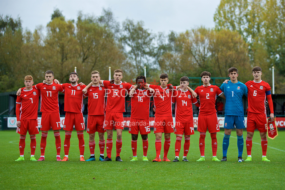 NEWPORT, WALES - Monday, October 14, 2019: Wales players line-up to sing the national anthem before an Under-19's International Friendly match between Wales and Austria at Dragon Park. (L-R) Sam Pearson, Lewis Collins, Joe Adams, Cameron Evans, Ryan Astley, Tivonge Rushesha, Sam Bowen, Harry Pinchard, Neco Williams, goalkeeper Lewis Webb, captain Morgan Boyes. (Pic by David Rawcliffe/Propaganda)