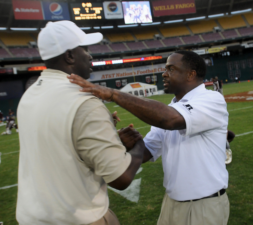 Washington DC--Morehouse College coach Rich Freeman, left, congratulates Howard University coach Gary Harrell, right, as time runs  out at the end of the AT&T Nation's Football Classic Saturday afternoon at RFK Stadium in Washington, DC . Howard University defeated Morehouse College 30-29.  (Photo by Alan Lessig)