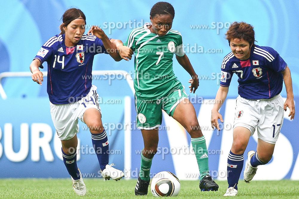 17.07.2010,  Augsburg, GER, FIFA U20 Womens Worldcup, Nigeria vs Japan,  im Bild Emi NAKAJIMA  (Japan Nr.14) Esther SUNDAY (Nigeria Nr.7) und Shoko YAMADA  (Japan Nr.17) im Kampf, EXPA Pictures © 2010, PhotoCredit: EXPA/ nph/ . Straubmeier+++++ ATTENTION - OUT OF GER +++++ / SPORTIDA PHOTO AGENCY