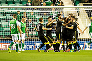 Livingston players celebrate their first goal (1-0) scored by Livingston defender Alan Lithgow (#4) during the Betfred Scottish Cup match between Hibernian and Livingston at Easter Road, Edinburgh, Scotland on 19 September 2017. Photo by Craig Doyle.