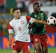 SZCZECIN 11/08/2010.FOOTBALL INTERNATIONAL FRIENDLY.POLAND v CAMEROON.Robert Lewandowski of Poland and Stephan Bikey of Cameroon.Fot: Piotr Hawalej / WROFOTO