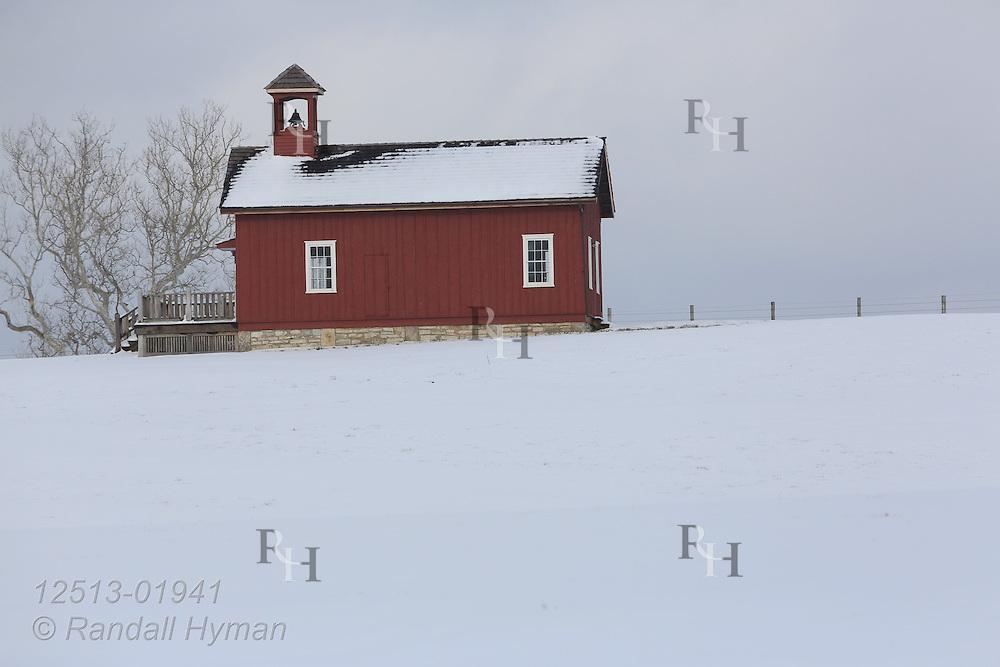 Snow blankets land around one-room schoolhouse near New Melle, Missouri.