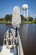 mop on boat on Bayou Lafourche
