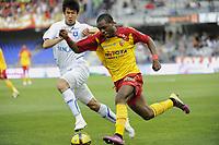 FOOTBALL - FRENCH CHAMPIONSHIP 2010/2011 - L1 - AJ AUXERRE v RC LENS - 24/04/2011 - PHOTO ALAIN GADOFFRE / DPPI - JOGOOK JUNG (AJA)/ HENRI BEDIMO (AJA)