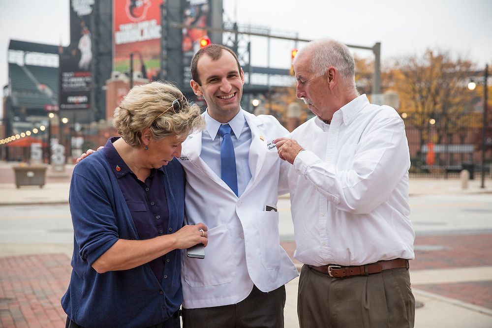 November 5, 2015, Baltimore, MD:<br /> Sue Battey, Thomas Battey, and Tim Battey pose after the University of Maryland Medical School Class of 2019 White Coat Ceremony at the Hilton Hotel in Baltimore, Maryland Thursday, November 5, 2015.<br /> (Photo by Billie Weiss)