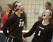 Mount Vernon's Hannah Whitley (20) and Morgan Melchert (1) are pumped up after a score during the WaMaC Tournament semifinal game at Mount Vernon High School in Mount Vernon on Thursday October 11, 2012. Solon defeated Mount Vernon 26-24, 25-22.