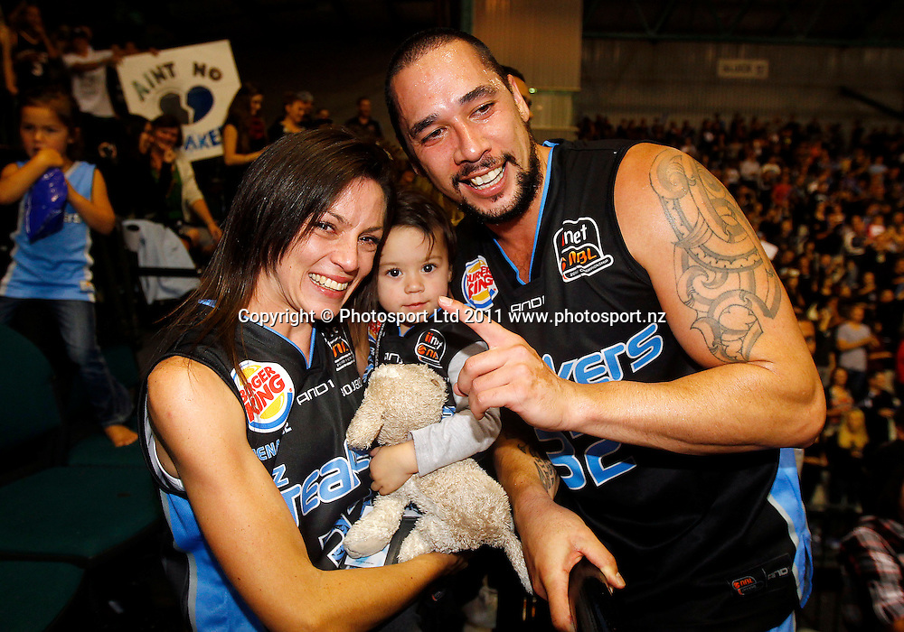 Paul Henare celebrates with his wife and child during the ANBL Grand Finals Game 3, Burger King Breakers v Cairns Taipans at the North Shore Event Centre Auckland, New Zealand on Friday 29 April 2011. Photo: Simon Watts/photosport.co.nz