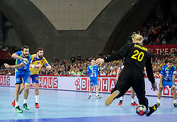 Dragan Gajic of Slovenia scores against Mikael Appelgren of Sweden during handball match between National teams of Sweden and Slovenia on Day 2 in Preliminary Round of Men's EHF EURO 2016, on January 15, 2016 in Centennial Hall, Wroclaw, Poland. Photo by Vid Ponikvar / Sportida