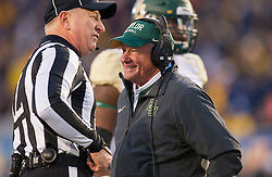 Dec 3, 2016; Morgantown, WV, USA; Baylor Bears head coach Jim Grobe talks with a referee during the second quarter against the West Virginia Mountaineers at Milan Puskar Stadium. Mandatory Credit: Ben Queen-USA TODAY Sports