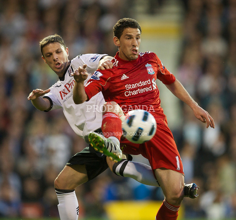LONDON, ENGLAND - Monday, May 9, 2011: Liverpool's Maximiliano Ruben Maxi Rodriguez and Fulham's Chris Baird during the Premiership match at Craven Cottage. (Photo by David Rawcliffe/Propaganda)