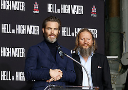 Chris Pine and David Mackenzie at Jeff Bridges Hand And Footprint Ceremony held at the TCL Chinese Theatre IMAX in Hollywood, USA on January 6, 2017.