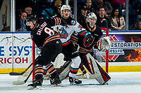 KELOWNA, BC - FEBRUARY 17: Matthew Wedman #20 of the Kelowna Rockets is checked by Tyson Galloway #8 in front of the net of Brayden Peters #35 of the Calgary Hitmen during first period at Prospera Place on February 17, 2020 in Kelowna, Canada. (Photo by Marissa Baecker/Shoot the Breeze)
