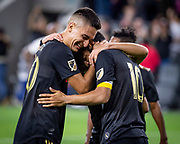 Los Angeles FC teammates Eduard Atuesta (20) and  Carlos Vela (10) celebrate after a goal during a MLS soccer match in Los Angeles, Saturday, April 13, 2019. LAFC defeated FC Cincinnati 2-0. (Ed Ruvalcaba/Image of Sport)