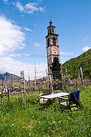 Ticino, Southern Switzerland. Intragna - bell tower of church seen from a nearby garden.