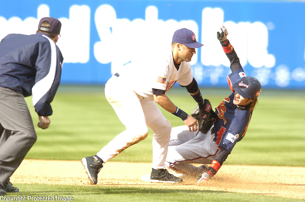 Team Japan's Tsuyoshi Nishioka slides under the tag of Team USA's Derek Jeter for a stolen base in the 8th inning in Round 2 action at Angel Stadium of Anaheim.