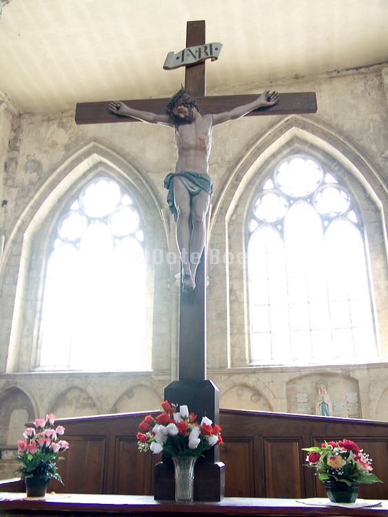 crucifix altar with flowers in a church