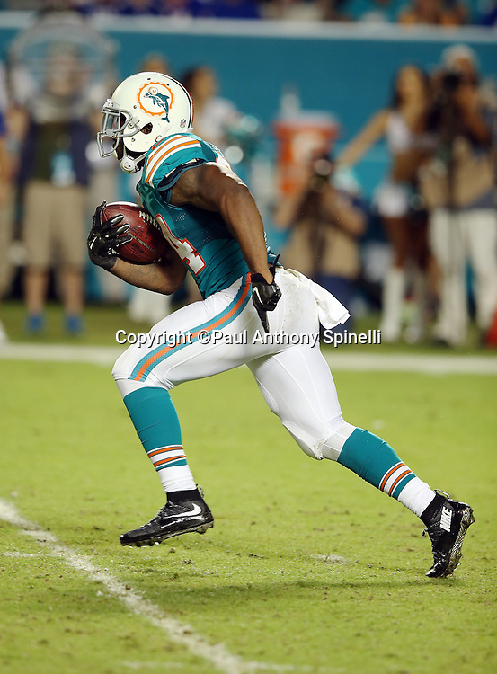 Miami Dolphins running back Damien Williams (34) returns a fourth quarter kick off during the NFL week 14 regular season football game against the New York Giants on Monday, Dec. 14, 2015 in Miami Gardens, Fla. The Giants won the game 31-24. (©Paul Anthony Spinelli)