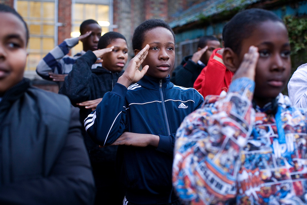 UK. London.Some of the boys at Eastside Young Leaders Academy run by Ray Lewis. The boys here do drill practice, a weekly activity which includes the academy salute.