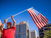 05 OCTOBER 2013 - PHOENIX, ARIZONA: A man waves an American flag during a march for immigration reform in Phoenix. More than 1,000 people marched through downtown Phoenix Saturday to demonstrate for the DREAM Act and immigration reform. It was a part of the National Day of Dignity and Respect organized by the Action Network.  PHOTO BY JACK KURTZ