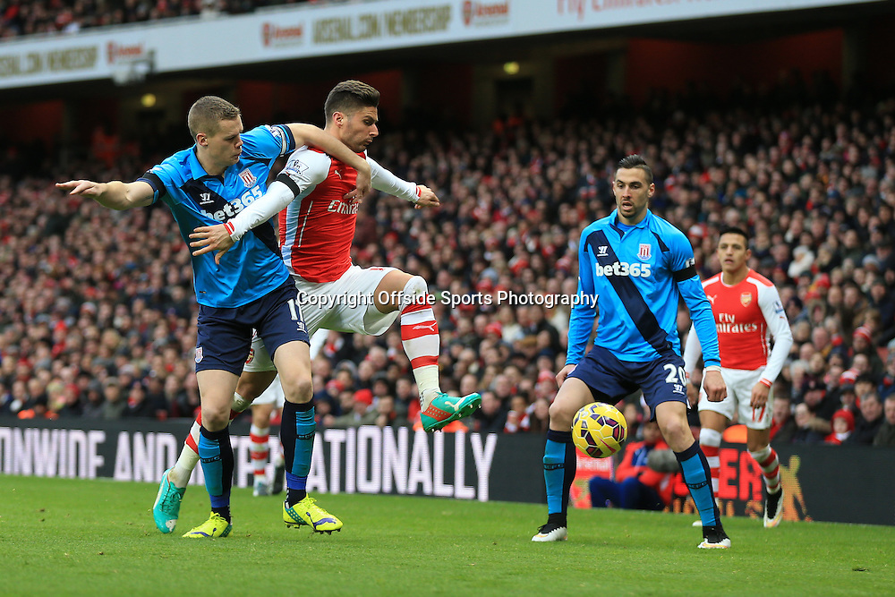 11 January 2015 - Barclays Premier League - Arsenal v Stoke City - Olivier Giroud of Arsenal tangles with Ryan Shawcross of Stoke City - Photo: Marc Atkins / Offside.