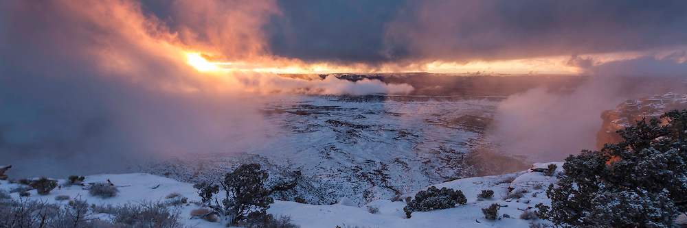 Fire explodes in the sunset sky after a Winter storm clears over Orange Canyon in Canyonlands National Park in Southern Utah.