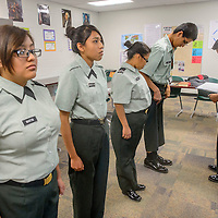 JROTC cadets form up as Anton Goodman, right performs an inspection at Wingate High School Wednesday.