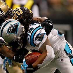 January 1, 2012; New Orleans, LA, USA; New Orleans Saints safety Isa Abdul-Quddus (42) tackles Carolina Panthers running back DeAngelo Williams (34) during the second quarter of a game at the Mercedes-Benz Superdome. Mandatory Credit: Derick E. Hingle-US PRESSWIRE