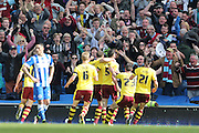Burnley defender Michael Keane (5) scores to make it 2-2 and celebrates with the Burnley fans during the Sky Bet Championship match between Brighton and Hove Albion and Burnley at the American Express Community Stadium, Brighton and Hove, England on 2 April 2016.