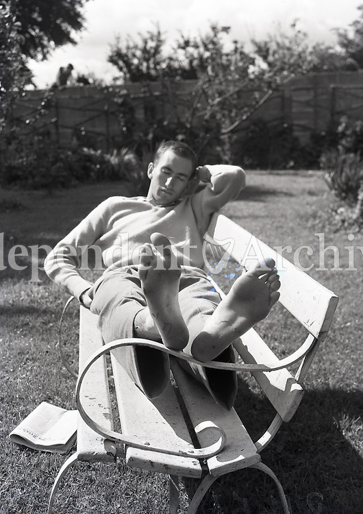 Australian Herb Elliott relaxes the day after he had broken the one mile world record in a time of 3.54.5 (previous was 3.58) to win the Morton Mile at Santry stadium. Ron Delany was 3rd in a time of 3.57.5. The first five over the line broke the 4-minute barrier. 6 August 1958. (Part of the Independent Ireland Newspapers/NLI Collection)