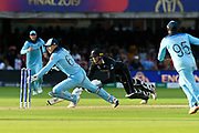 England Are World Champions - Jos Buttler of England breaks the stumps to complete the run out of Martin Guptill of New Zealand in the super over and England win the World Cup during the ICC Cricket World Cup 2019 Final match between New Zealand and England at Lord's Cricket Ground, St John's Wood, United Kingdom on 14 July 2019.